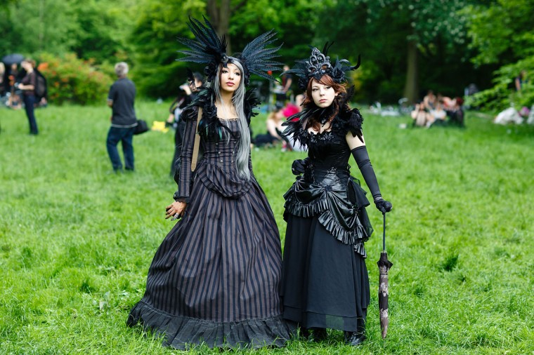 Participants in black clothing and feather-hats pose for pictures during the traditional park picnic on the first day of the annual Wave-Gotik Treffen, or Wave and Goth Festival, on May 17, 2013 in Leipzig, Germany. (Marco Prosch/Getty Images)