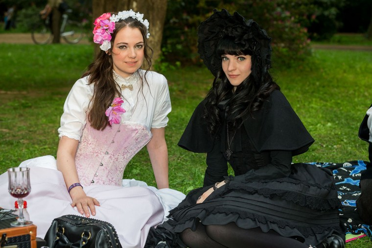 Two girls in black and white Victorian clothing pose for pictures during the traditional park picnic on the first day of the annual Wave-Gotik Treffen, or Wave and Goth Festival, on May 17, 2013 in Leipzig, Germany. (Marco Prosch/Getty Images)