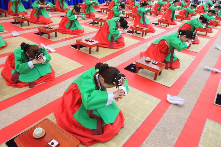 Young South Koreans in traditional clothing participate in a traditional Confucian coming-of-age ceremony on May 20, 2013 in Seoul, South Korea. The ceremony was organized to celebrate the coming-of-age of young people who have turned 20 this year or are going to turn 20 this year and to increase their awareness about the responsibilities of adulthood. (Chung Sung-Jun/Getty Images)