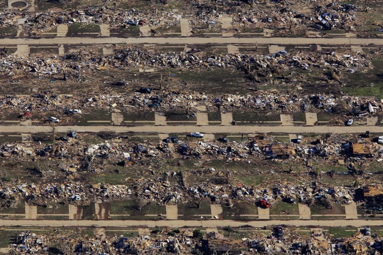 An aerial view of destroyed houses and buildings after a powerful tornado ripped through the area on May 21, 2013 in Moore, Oklahoma. The town reported a tornado of at least EF4 strength and two miles wide that touched down yesterday killing at least 24 people and leveling everything in its path. U.S. President Barack Obama promised federal aid to supplement state and local recovery efforts. (Benjamin Krain/Getty Images)