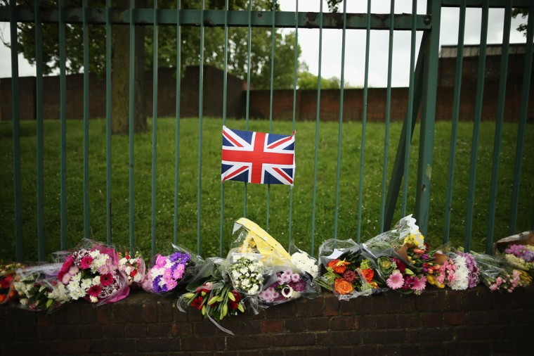 Flowers lay close to the scene where Drummer Lee Rigby of the 2nd Battalion the Royal Regiment of Fusiliers was killed in London, England. Drummer Lee Rigby of the 2nd Battalion the Royal Regiment of Fusiliers was murdered by suspected Islamists near London's Woolwich Army Barracks. The UK's security services are facing a Commons inquiry after confirmation that the two men arrested were known to MI5. (Dan Kitwood/Getty Images)