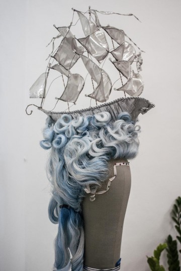 A sailing boat adorns one of the Sari Rambut's wigs in their office on May 21, 2013 in Bangli, Bali, Indonesia. (Putu Sayoga/Getty Images)