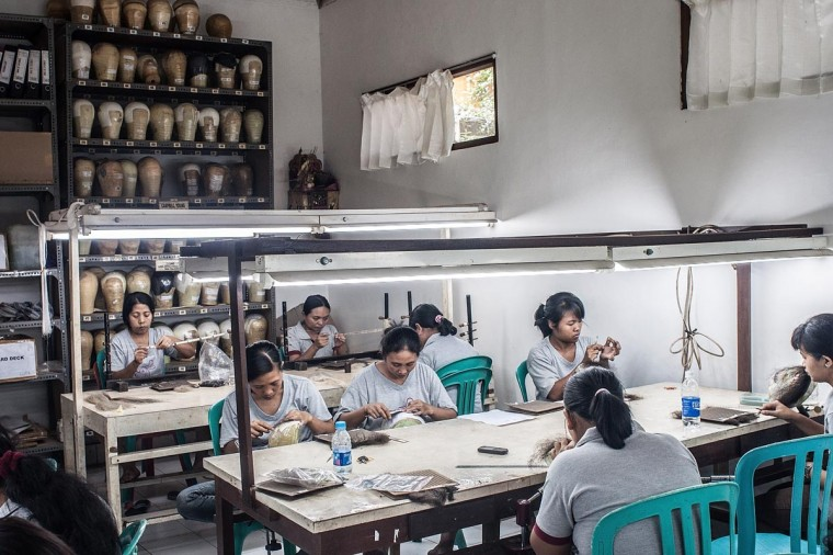 Employees work to make theatrical and film wigs at the Sari Rambut wig production on May 21, 2013 in Bangli, Bali, Indonesia. (Putu Sayoga/Getty Images)