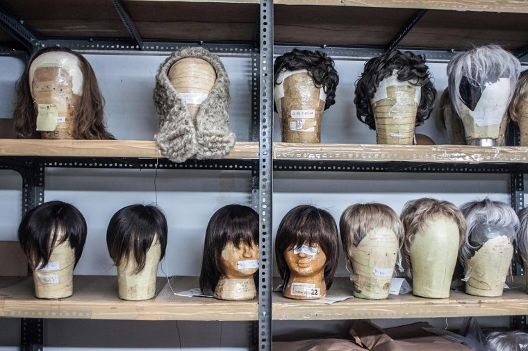 Completed wigs rest on mannequin heads on a shelf on May 21, 2013 in Bangli, Bali, Indonesia at Sari Rambut. (Putu Sayoga/Getty Images)