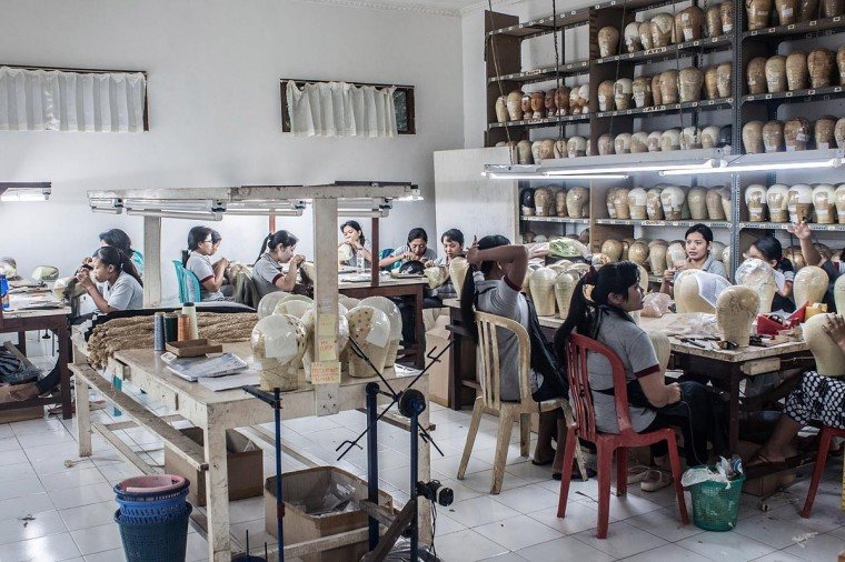 Employees work to make theatrical and film wigs at Sari Rambut wig production on May 21, 2013 in Bangli, Bali, Indonesia. Sari Rambut is one of the most well respected theatrical and film wig producers for the global entertainment industry. (Putu Sayoga/Getty Images)