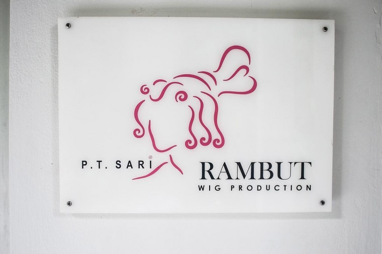 A sign for Sari Rambut wig production on May 21, 2013 in Bangli, Bali, Indonesia. (Putu Sayoga/Getty Images)