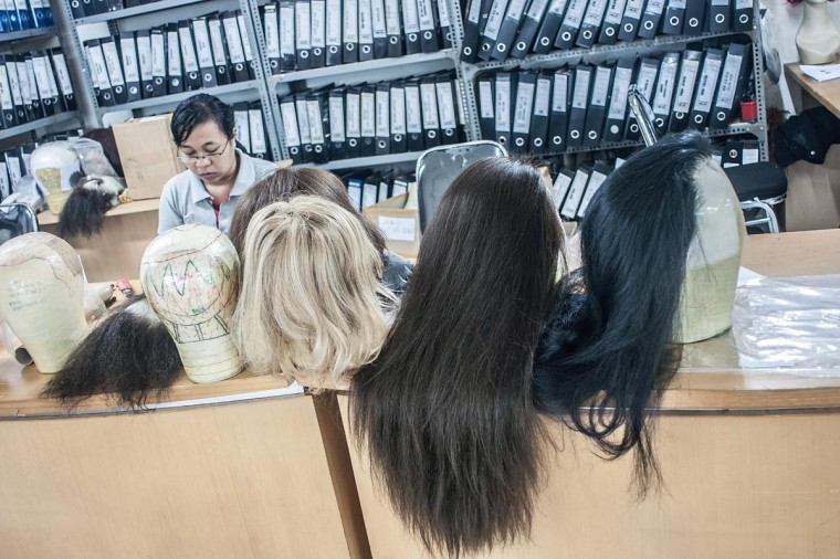 Completed wigs rest on a table on May 21, 2013 in Bangli, Bali, Indonesia at Sari Rambut. (Putu Sayoga/Getty Images)
