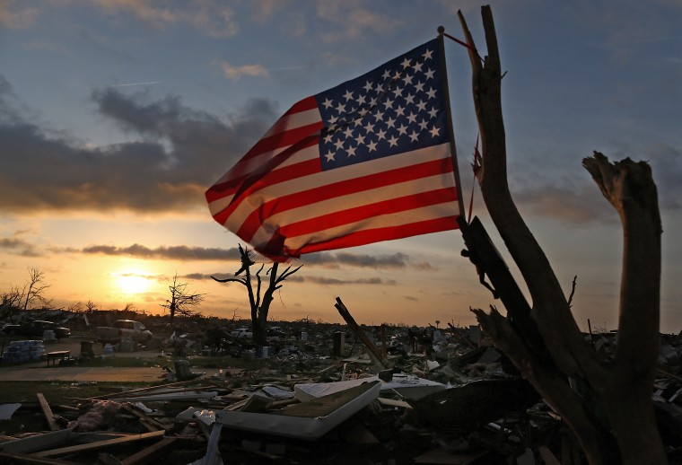 Residents and volunteers in Moore, Oklahoma observed the Memorial Day holiday by continuing to recover valuables from neighborhoods destroyed by the May 20 tornado. (Tom Pennington/Getty Images)