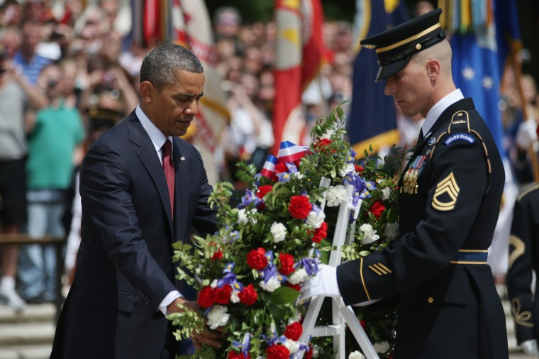 President Barack Obama positions a commemorative wreath during a ceremony on Memorial Day at the  Tomb of the Unknown Solider at Arlington National Cemetery. (Mark Wilson/Getty Images)
