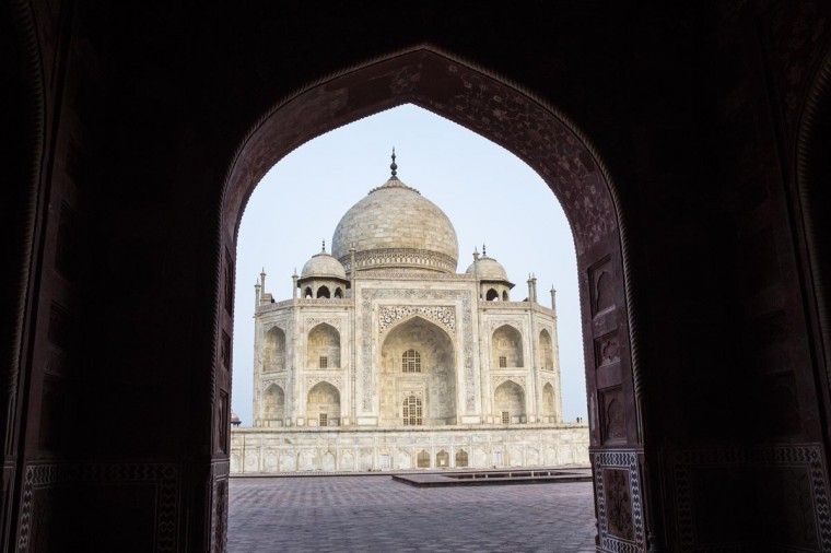 The Taj Mahal is seen through an archway from the East on May 28, 2013 in Agra, India. Completed in 1643, the mausoleum was built by the Mughal emperor Shah Jahan in memory of his third wife, Mumtaz Mahal, who is buried there alongside Jahan. (Daniel Berehulak/Getty Images)