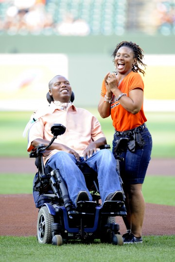 O.J. and Chandra Brigance at the mound for the first pitch ceremony. Their foundation also helps fund ALS research. (Mitchell Layton/Getty Images)