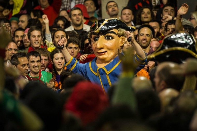 Revelers surround the 'Nans Vells,' old dwarves in Catalan, during the first day of 'La Patum' Festival on May 30, 2013 in Berga, Spain. The Patum festival's roots are found in the theatrical performances of the Middle Ages and is held in the town of Berga each year during the week of Corpus Christi. (David Ramos/Getty Images)