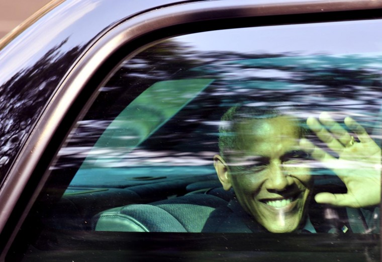 U.S. President Barack Obama waves through the window of his car in Mexico City, on May 2, 2013. Obama landed in Mexico on Thursday at the start of a three-day trip that will also take him to Costa Rica, with trade, U.S. immigration reform and the drug war high on the agenda. (Hector Guerrero/AFP/Getty Images)