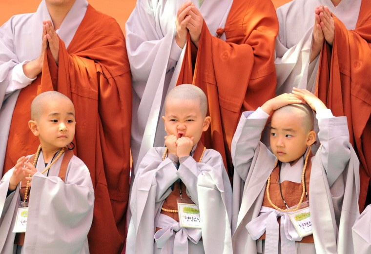 "Young South Korean Buddhists with freshly shaved heads line up as they take part in a ceremony called ""children becoming Buddhist monks"" at Chogye Temple ahead of Buddha's birthday in central Seoul. Buddha's official birthday in 2013 will be celebrated on the full moon on May 17 in South Korea. (Kim Jae-Hwan/AFP/Getty Images)"