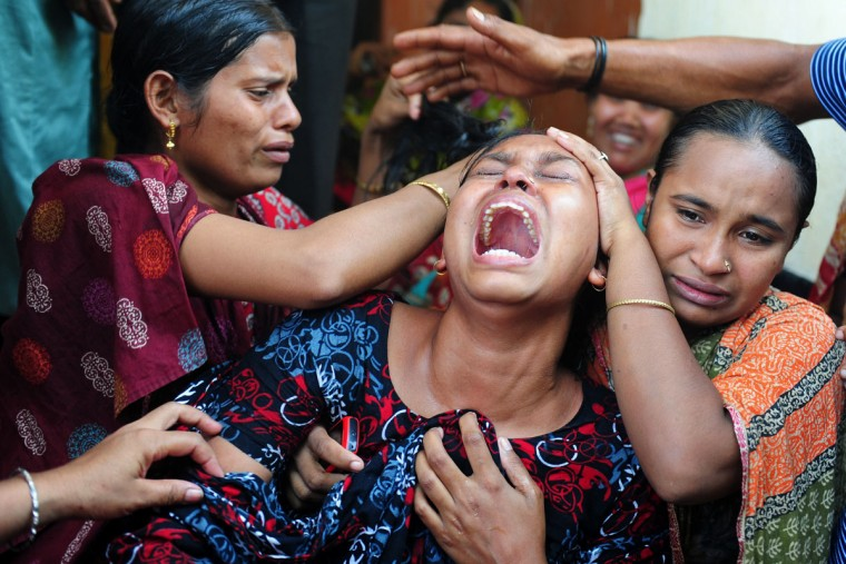 Relatives react after identifying the body of a loved one killed in last week's building collapse in Savar, on the outskirts of Dhaka, on May 3, 2013. (Munir uz Zaman/AFP/Getty Images)