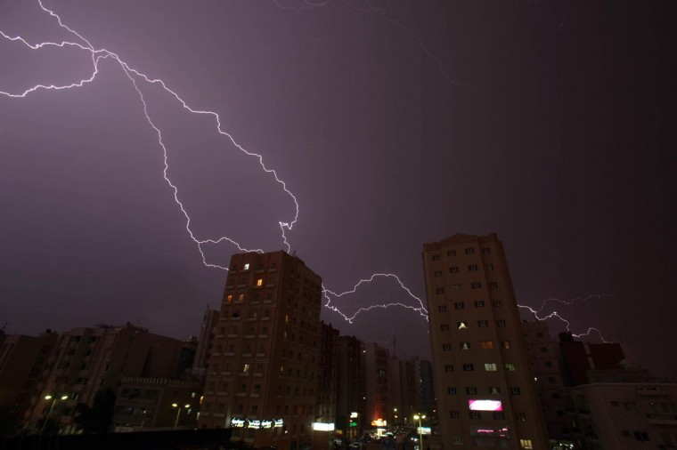 Lightning strikes the sky over Kuwait City during a thunder storm early on May 5, 2013. (Yasser Al-Zayyat/AFP/Getty Images)