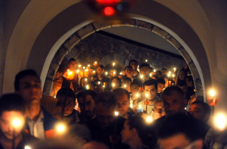 Macedonian Orthodox believers celebrate Easter in Saint-Jovan Bigorski monastery some 145 km west from the capital Skopje, early on May 5, 2013. The Macedonian Orthodox Church celebrated Easter, according to the Julian calendar. (Robert Atanasovski/AFP/Getty Images)