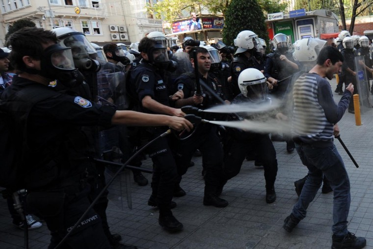 Turkish riot police spray tear gas on protestors on May 5, 1013, during a demonstration against the government and on the anniversary of the execution of Denis Gezmis, one of the founders of the People's Liberation army of Turkey (THKO) on Istiklal Avenue in Istanbul. (Bulent Kilic/AFP/Getty Images)