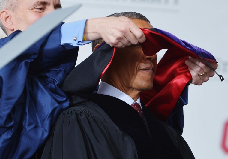 U.S. President Barack Obama is hooded as he receives an honorary degree during the commencement ceremony at Ohio State University on May 5, 2013 in Columbus, Ohio. (Mandel Ngan/AFP/Getty Images)