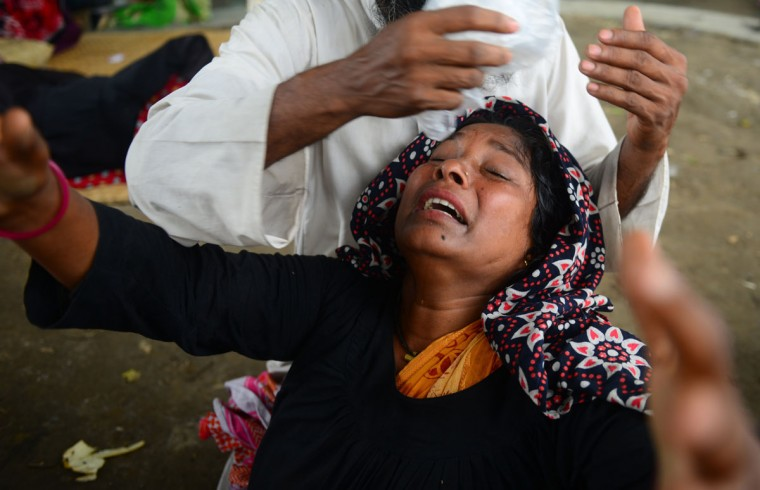 A relative reacts after identifying the body of a loved one killed in last week's building collapse in Savar, on the outskirts of Dhaka on May 10, 2013. The death toll from last month's collapse of a garment factory complex in Bangladesh rose past 1,000 as piles of bodies were found in the ruins of a stairwell where victims had sought shelter. (Munir uz Zaman/AFP/Getty Images)