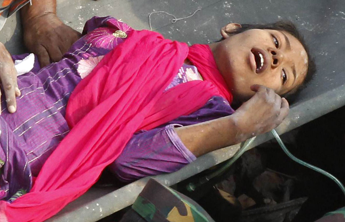 Bangladesh woman rescued after 17 days in garment factory rubble