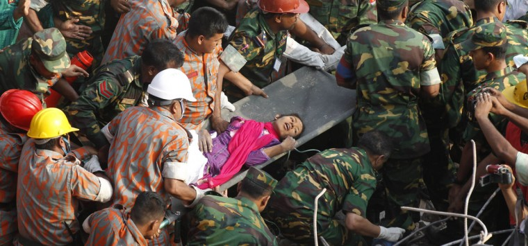 Bangladeshi rescuers retrieve garment worker Reshma from the rubble of a collapsed building in Savar on May 10, 2013, 17 days after the eight-story building collapsed. The death toll from last month's collapse of a garment factory complex in Bangladesh rose past 1,000 as piles of bodies were found in the ruins of a stairwell where victims had sought shelter. (STR/AFP/Getty Images)