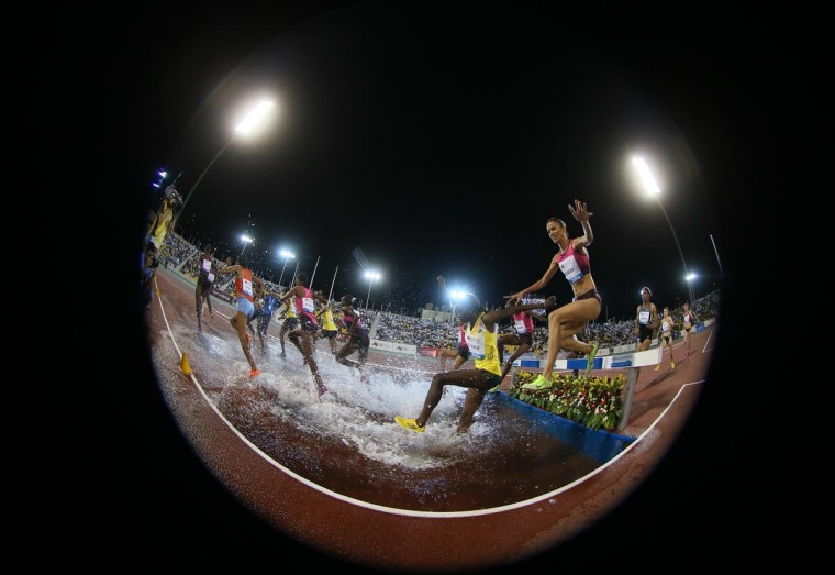 Athletes compete in the women's 3000m steeplechase at the IAAF Diamond League in the Qatari capital Doha on May 10, 2013. (Karim Jaafar/AFP/Getty Images)