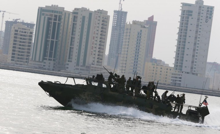 A U.S. Navy River Command Boat cruises off the coast of Bahrain's Salman port, near the capital Manama, on May 12, 2013, one day before the start of the biggest exercise of mine countermeasure maneuvers in the Arabian Gulf. The U.S. Navy along with other 40 nations are conducting the games. (Marwan Naamani/AFP/Getty Images)