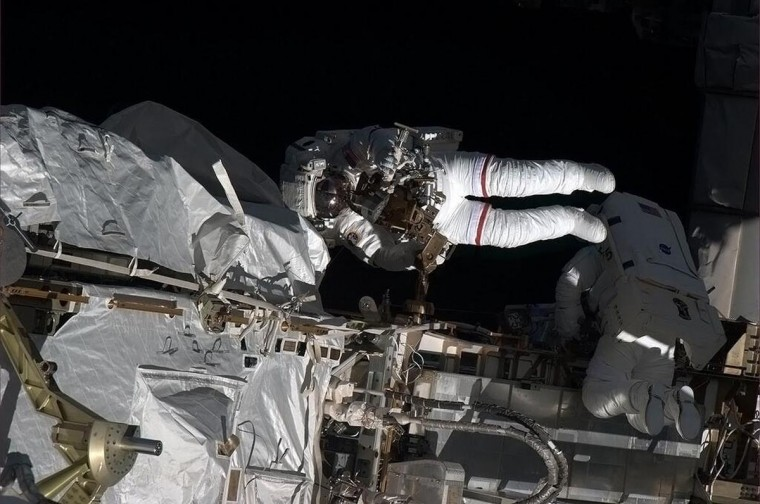 This May 11, 2013 NASA handout image captured by Canadian astronaut Chris Hadfield on board the International Space Station (ISS) shows astronauts Tom Marshburn and Chris Cassidy during a spacewalk to make repairs. NASA HO via AFP/Getty Images)