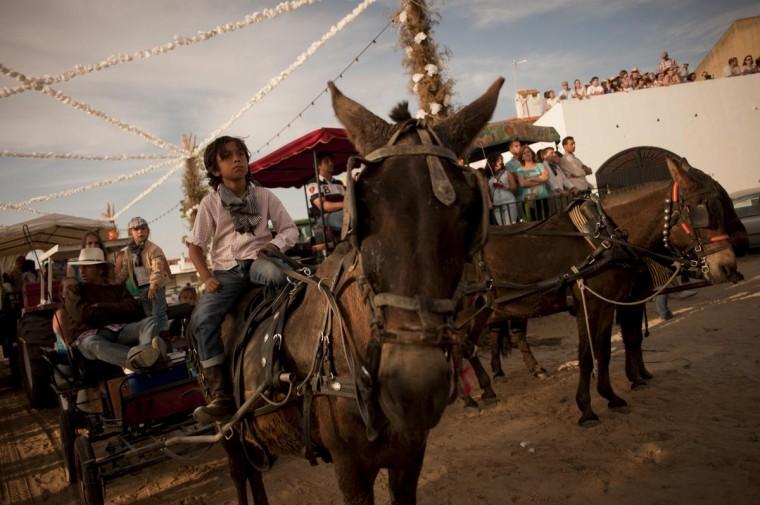 Pilgrims attend the El Rocio Romeria pilgrimage in the village of El Rocio near Huelva on May 12, 2013. Once every seven years the Virgen del Rocio travels from Almonte to El Rocio. (Jorge Guerrero/AFP/Getty Images)