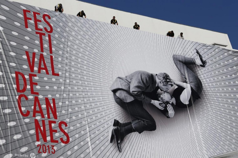 Workers set up a the giant official poster of the 66th Cannes Film Festival, featuring a 50-year-old photo of Hollywood love match Paul Newman and Joanne Woodward locked in a tender embrace, on May 13, 2013 on the facade of the palais des festivals in Cannes, southeastern France. Cannes, one of the world's top film festivals, opens on May 15 and will climax on May 26 with awards selected by a jury headed this year by Hollywood legend Steven Spielberg. (Valery Hache/AFP/Getty Images)