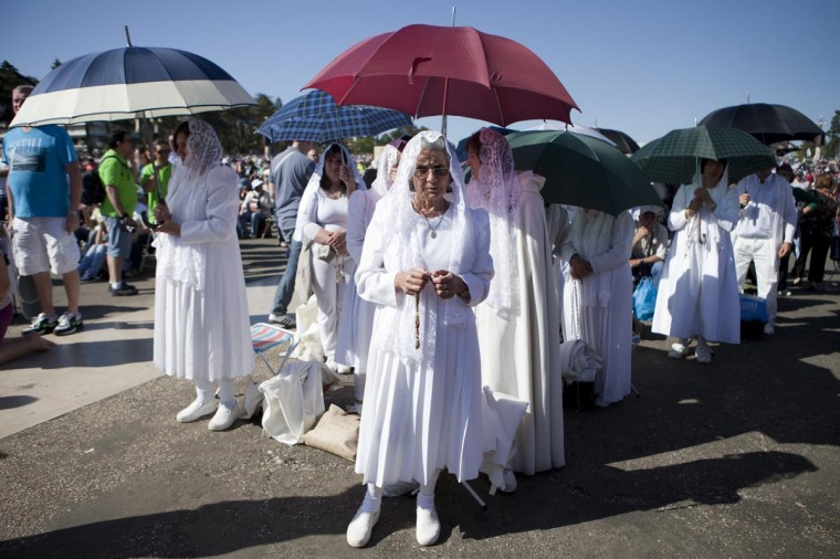 Pilgrims attend a mass ceremony at the Fatima catholic shrine in Fatima, central Portugal, on May 13, 2013. Thousands converged on Fatima Santuary to celebrate the anniversary of the Fatima miracle when three shepherd children claimed to having seen the Virgin Mary in May 1917. (Pedro Nunes/AFP/Getty Images)