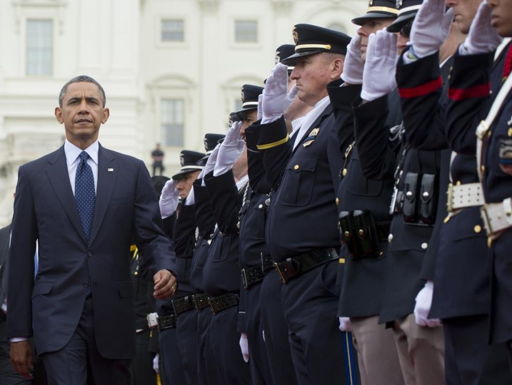 U.S. President Barack Obama walks past a police honor guard as he arrives to attend the National Peace Officers Memorial Service, an annual ceremony honoring law enforcement who were killed in the line of duty in the previous year, at the US Capitol in Washington, DC, May 15, 2013. (Saul Loeb/AFP/Getty Images)