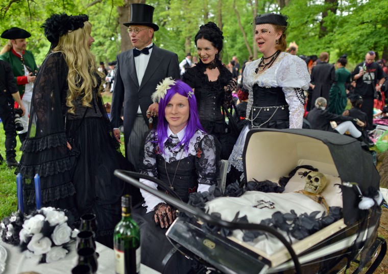 Vistors to a Wave-Gothic meeting have a pram with skeleton in it on May 17, 2013 in Leipzig, eastern Germany. (Hendrik Schmidt/AFP/Getty Images)