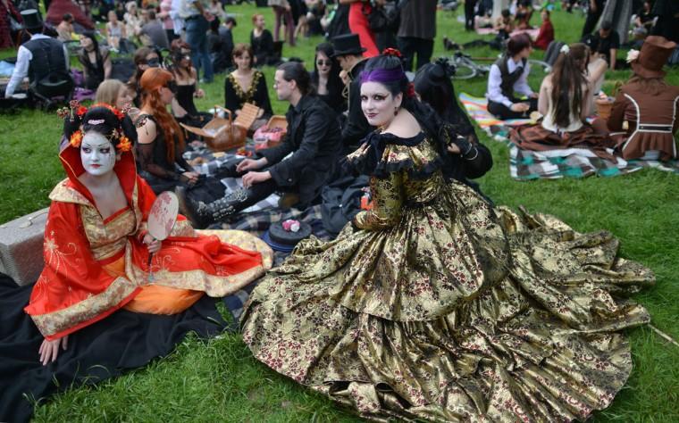 People attend a Victorian picknick at a Wave-Gothic meeting on May 17, 2013 in Leipzig, eastern Germany. (Hendrik Schmidt/AFP/Getty Images)