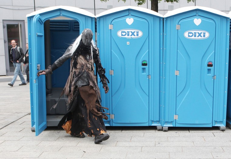A participant of a Wave-Gothic meeting leaves a port-a-potty on May 19, 2013 in Leipzig, eastern Germany. (Sebastian Willnow/AFP/Getty Images)