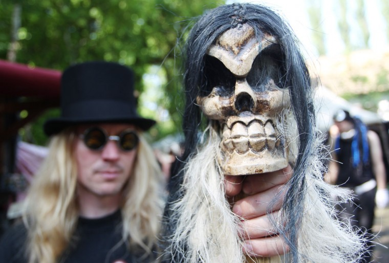A man poses with a skull cane during the 22nd Wave Gothic Festival in Leipzig, Germany, on May 19, 2013. (Sebastian Willnow/AFP/Getty Images)