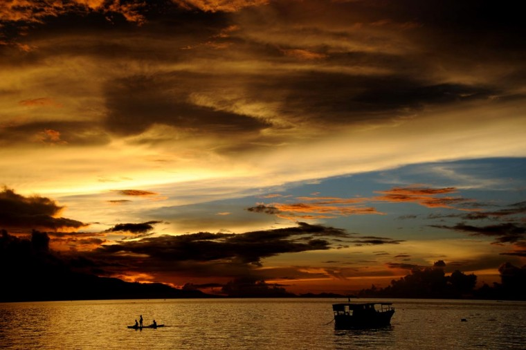 Fishermen (L) paddle a traditional boat during sunset at Waiara beach in Maumere on Flores island in East Nusa Tenggara on May 20, 2013. The Indonesian government has set the ambitious target of welcoming a total of nine million foreign tourists in 2013 increasing to 10 million by 2014. (Sonny Tumbelaka/AFP/Getty Images)