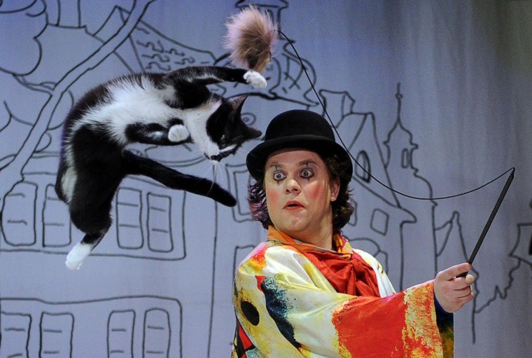 A picture taken on May 3, 2013, shows Vladimir Kouklatchev performing with a cat during a show in the Moscow Cat Theatre, founded by his father, famous Russian clown Yuri Kouklatchev, shortly before the fall of the USSR. The theatre was recently re-opened after a top to bottom renovation. (Yuri Kadobnov/AFP/Getty Images)