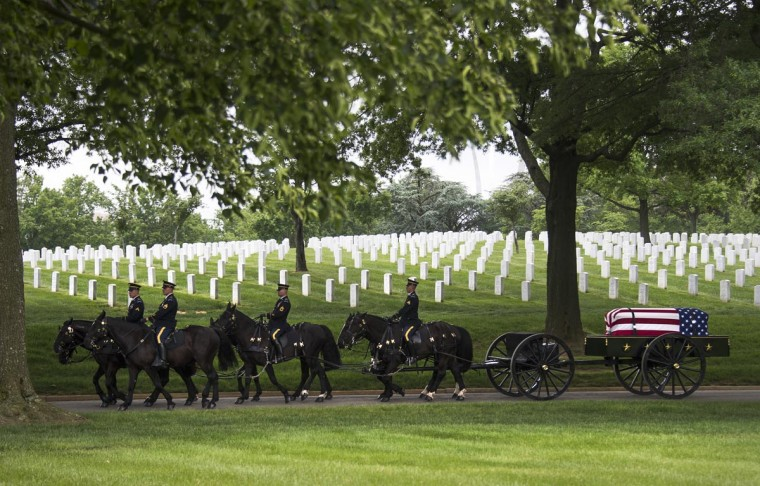 "Members of the US Army's 3rd Infantry Regiment ""The Old Guard"" perform a full military honors burial service for US Army Staff Sergeant Francis G. Phillips IV at Arlington National Cemetery in Arlington, Virginia on May 20, 2013. (Jim Watson/AFP/Getty Images)"