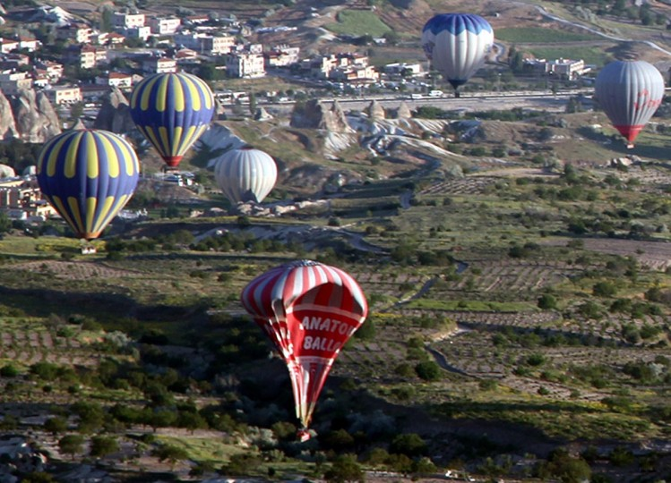 A hot air balloon falls to the ground after colliding with another during a trip in Cappadocia near Neveshir on May 20, 2013. Two Brazilian tourists died Monday and 23 other people were hurt after two hot-air balloons collided in central Turkey, officials said. (Anadolu/AFP/Getty Images)