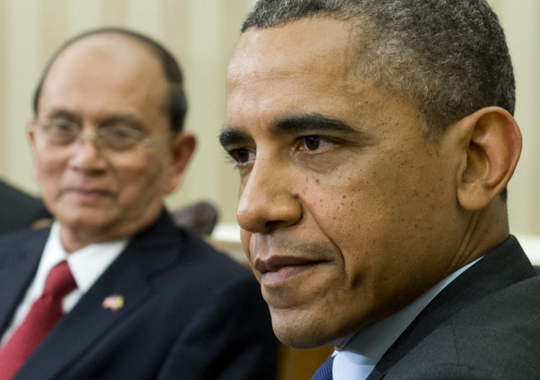 U.S. President Barack Obama and President Thein Sein of Myanmar (L) hold meetings in the Oval Office of the White House in Washington, DC, May 20, 2013. Thein Sein becomes the first leader of Myanmar to visit the White House in nearly half a century, as Washington offers a strong symbolic gesture to back his reforms. (Saul Loeb/AFP/Getty Images)