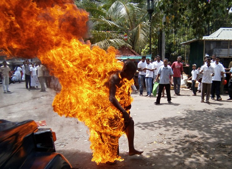 Sri Lankan Buddhist monk Bowatte Indaratane is engulfed in flames after he set himself on fire in the central town of Kandy. Indaratane self-immolated in the central town of Kandy to protest against the slaughter of cattle in the country, reports said. (J.A.L Jayasinghe/AFP/Getty Images)