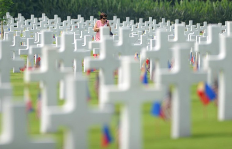 A woman walks amongst the graves of soldiers who fell during World War II, searching for a grave of a relative during a service to mark US Memorial Day at the Manila American Cemetery in Fort Bonifacio in Manila on May 26, 2013. At least 17,000 graves are in the park that pays tribute to US and Philippines soldiers that fought side-by-side during World War II. The US marks Memorial Day on May 27. (Noel Celis/AFP/Getty Images)