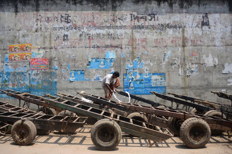 A Bangladeshi worker ties his pushcart during a nationwide strike called by the Bangladesh Nationalist Party (BNP) in Dhaka on May 26, 2013. The country's opposition parties have combined to enforce the shutdown as they demand the restoration of the caretaker government system during national elections. (Munir uz Zaman/AFP/Getty Images)