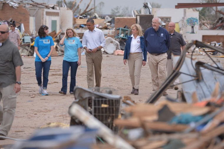 U.S. President Barack Obama visits the tornado affected Plaza Towers Elementary School on May 26, 2013 in Moore, Oklahoma. Obama is in the Oklahoma City area to survey damage from the tornado which struck a week ago and meet with victims and first responders. Oklahoma Governor Mary Fallin is third from right. (Mandel Ngan/AFP/Getty Images)