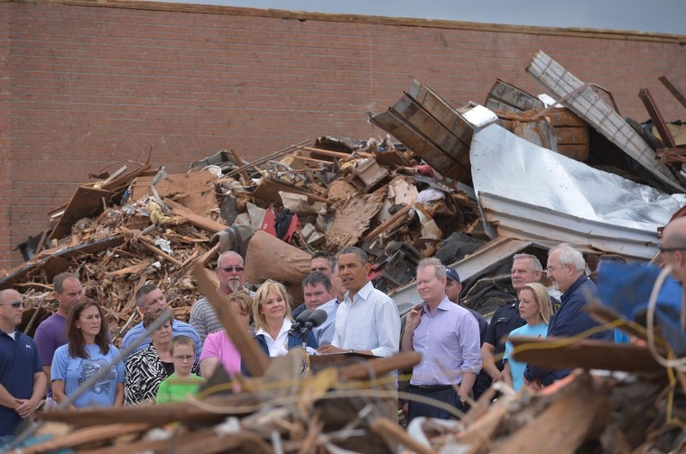U.S. President Barack Obama speaks at the tornado affected Plaza Towers Elementary School on May 26, 2013 in Moore, Oklahoma. Obama is in the Oklahoma City area to survey damage from the tornado which struck a week ago and meet with victims and first responders. (Mandel Ngan/AFP/Getty Images)