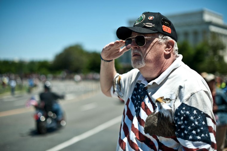 A man salutes as members of the U.S. military veterans' Rolling Thunder bikers group ride past in Washington on May 26, 2013 as the country marks Memorial Day. (Nicholas Kamm/AFP/Getty Images)