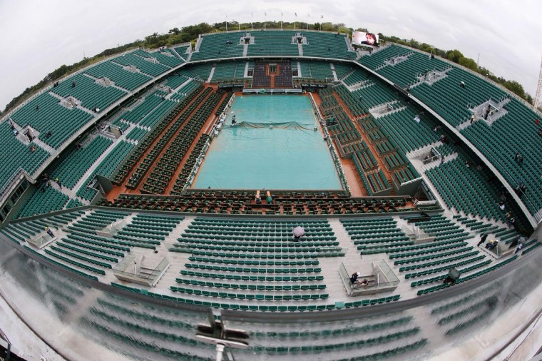 The Philippe Chatrier central court is covered as rain falls on the third day of the French tennis Open at the Roland Garros stadium in Paris on May 28, 2013. (Kenzo Tribouillard/AFP/Getty Images)
