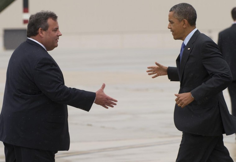 U.S. President Barack Obama shakes hands with New Jersey Governor Chris Christie (L) after arriving at Joint Base McGuire-Dix in New Jersey on May 28, 2013. Obama is traveling to the New Jersey shore to view rebuilding efforts following last year's Hurricane Sandy. (Saul Loeb/AFP/Getty Images)